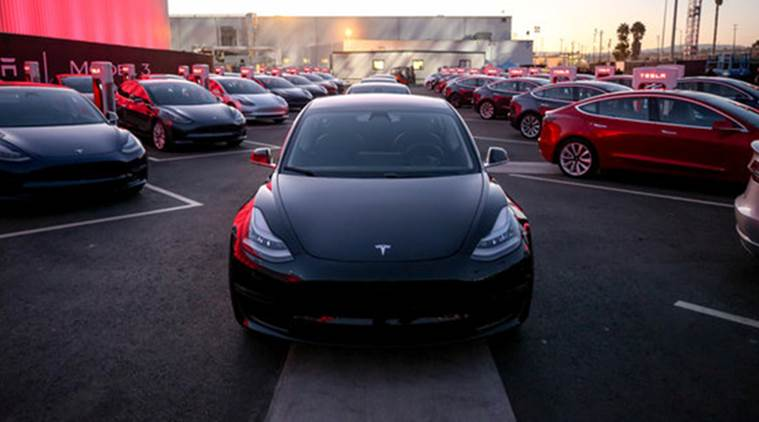 Tesla Model 3 cars are seen as Tesla holds an event at the factory handing over its first 30 Model 3 vehicles to employee buyers at the company's Fremont facility in California